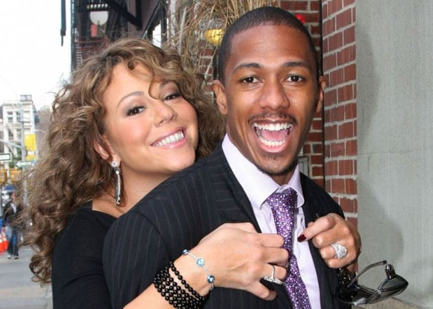 Mariah Carey and Nick Cannon bid $21,000 at charity event