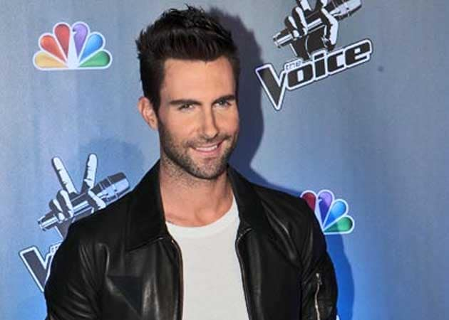 Adam Levine spotted kissing new girlfriend