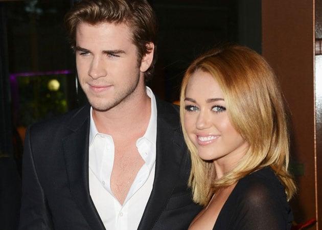 "Miley Cyrus is driving fiancé Liam Hemsworth ""crazy"""