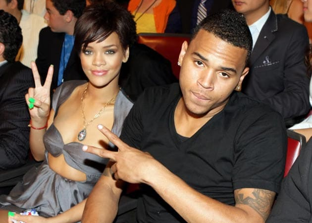 Rihanna finds it hard to hide the fact she still loves Chris Brown