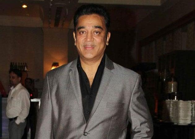 Kamal Haasan writing script for Ramesh Aravind's Uthama Villain