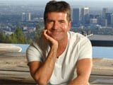 Simon Cowell may marry pregnant girlfriend next year