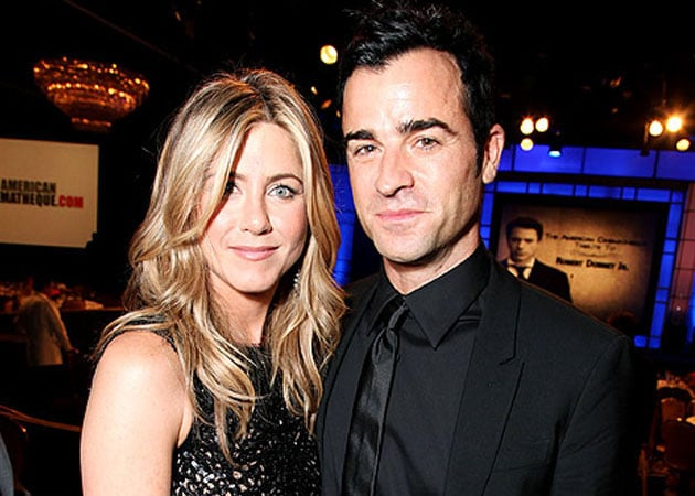 Jennifer Aniston, Justin Theroux wedding postponed, again