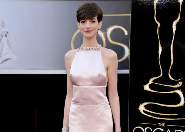 Anne Hathaway shooed paparazzi away with dog's poop