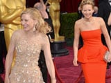 Oscars 2014: Cate Blanchett shows Jennifer Lawrence how not to trip over her dress