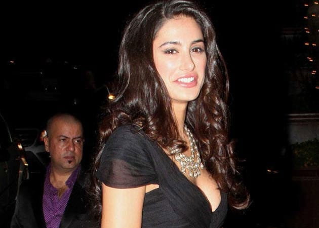 Nargis Fakhri gets her picture taken with 50 Cent
