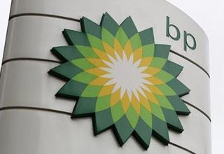 BP quarterly profits fall as oil spill still weighs