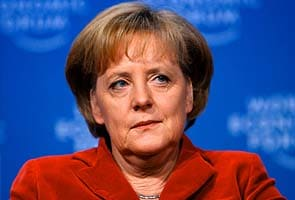 Merkel tries to calm storms over Greece, ECB policy