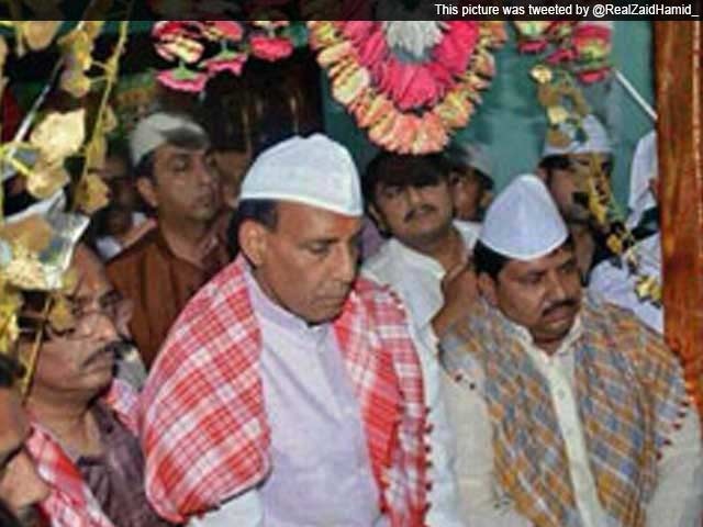 Video : BJP chief Rajnath Singh wears traditional <i>topi</i> at Lucknow shrine