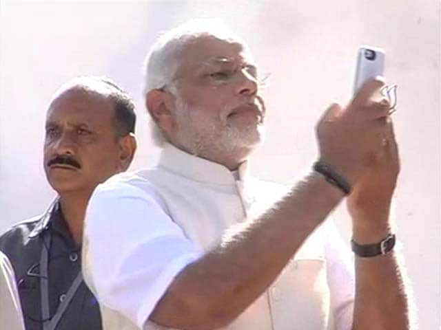 Video : Watch: Narendra Modi takes a selfie after voting in Ahmedabad