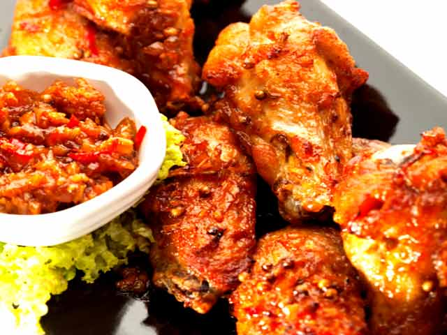 Bhuna masala chicken wings ndtv food videos yes chicken marinated in exotic indian spices and fried beautiful golden brown closing with a red chilly tadka a quick and easy pack away for your forumfinder Choice Image