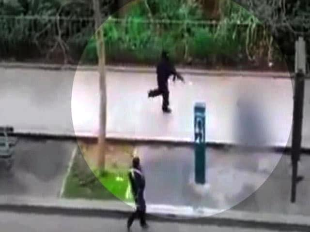 Video : Charlie Hebdo Attack: Video of Gunmen Shooting Man on Pavement