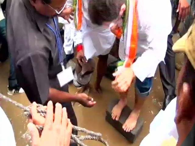 Video : Former Minister Holds Slippers for Rahul Gandhi in Flooded Puducherry