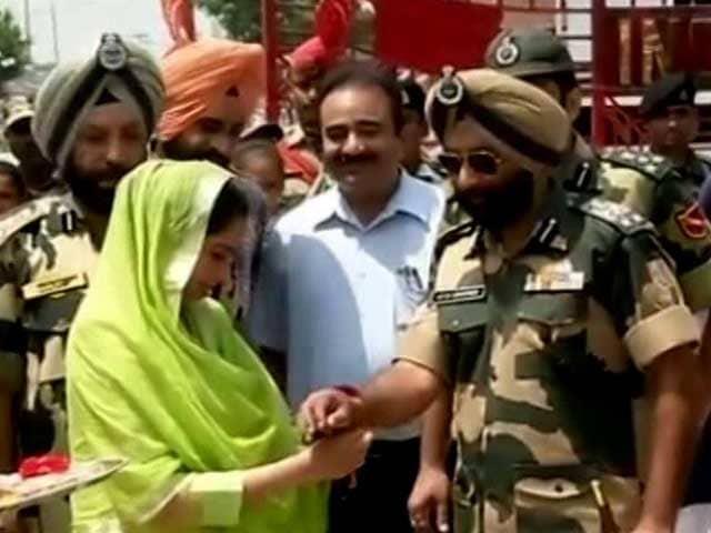 Video : Union Minister Harsimrat Kaur Badal Ties Rakhis On BSF Troopers