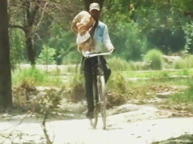 Video : No Ambulance, UP Man Carried Dead Baby On Cycle, Stretcher Used In Odisha