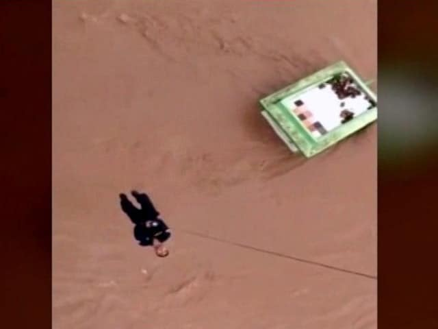 Video : Watch: Dangling From Chopper, Rescuer Helps Flood Victims In Gujarat