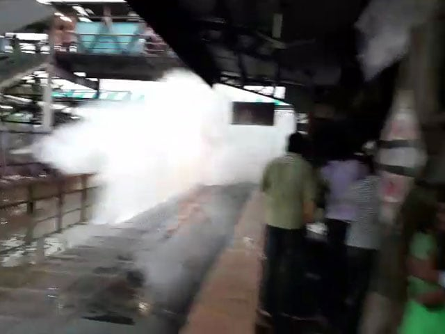 Video : Viral Video: Train Splashes Water On Waiting Commuters In Mumbai