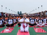 Video : PM Modi Performs Yoga <i>Asanas</i> Amid Rain, Thousands Join Him