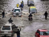 Videos : भारी बारिश को लेकर मुंबई में रेड अलर्ट